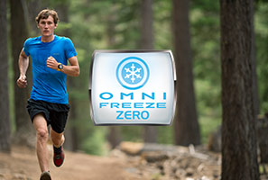 A man wearing an Omni-Freeze ZERO shirt is training on a hot, summer day.