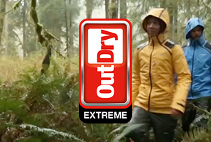 Two hikers wearing OutDry Extreme rain shells in a rain forest.