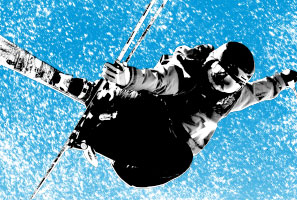 A freestyle skier is in mid-air and is performing tricks.